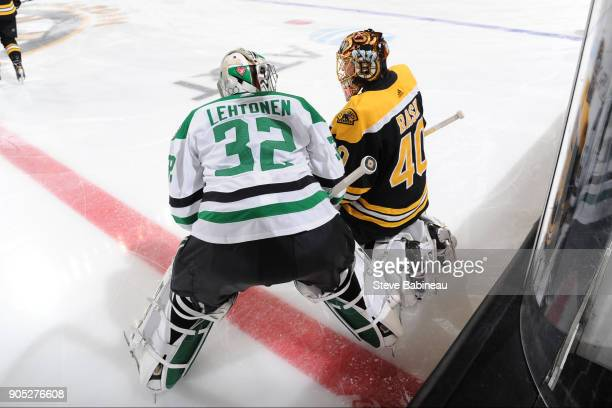 Tuukka Rask of the Boston Bruins chats during warm ups before the game with Karl Lehtonen of the Dallas Stars at the TD Garden on January 15 2018 in...