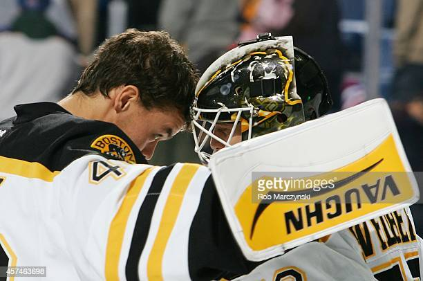 Tuukka Rask of the Boston Bruins congratulates goaltender Niklas Svedberg after his 40 shutout victory against the Buffalo Sabres on October 18 2014...
