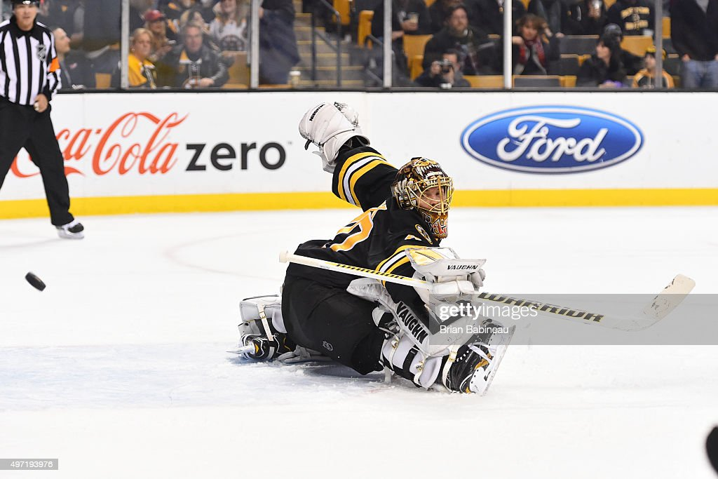 Tuukka Rask #40 of the Boston Bruins deflects the puck against the Detroit Red Wings at the TD Garden on November 14, 2015 in Boston, Massachusetts.