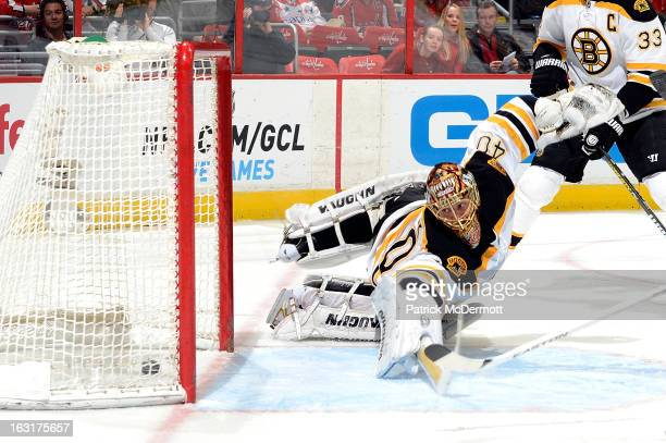 Tuukka Rask of the Boston Bruins dives but cant make the save as Mike Ribeiro of the Washington Capitals scores in the second period of an NHL game...