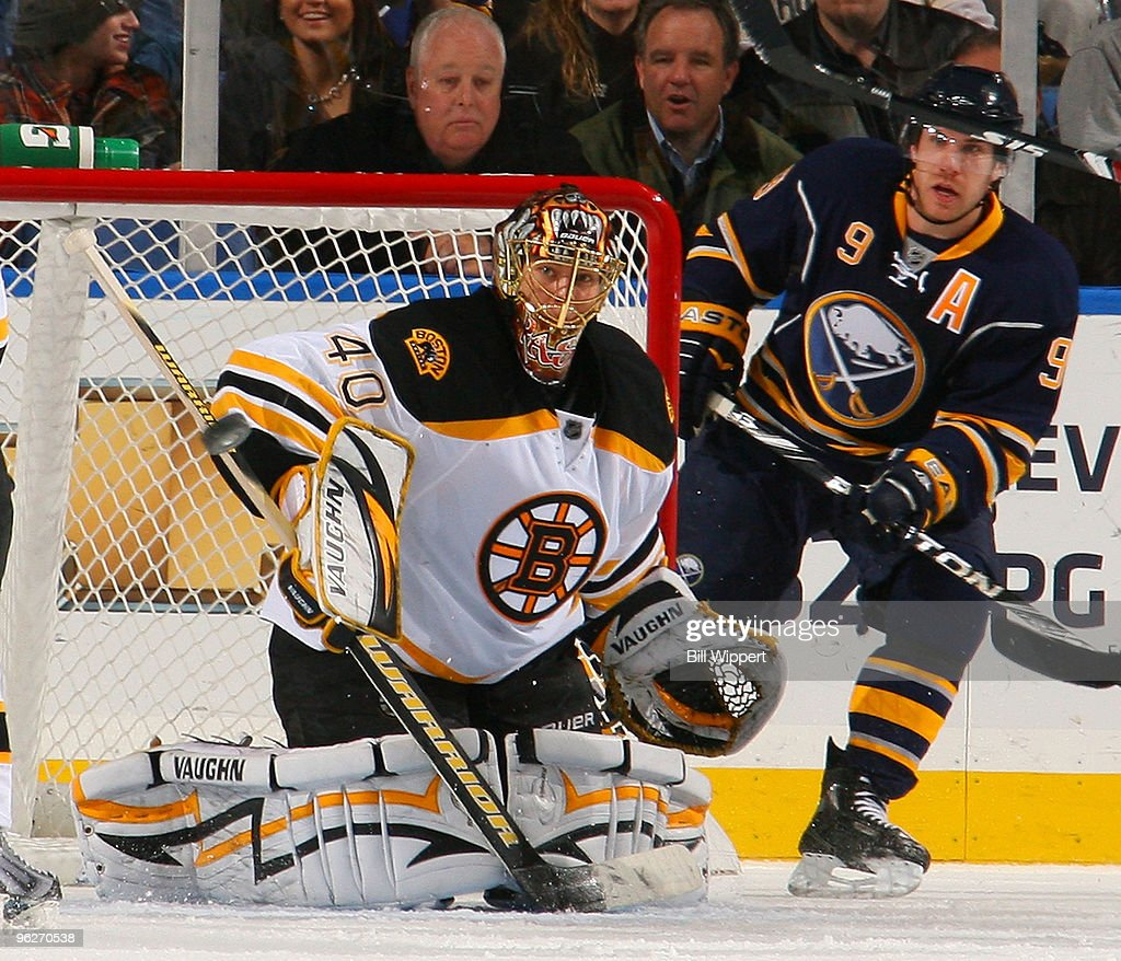Tuukka Rask #40 of the Boston Bruins eyes the puck in front of Derek Roy #9 of the Buffalo Sabres on January 29, 2010 at HSBC Arena in Buffalo, New York.
