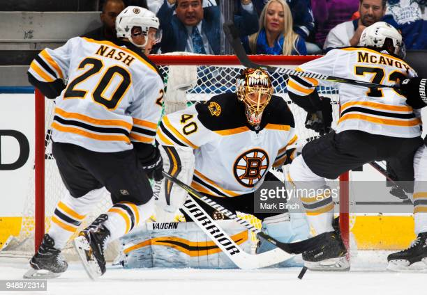 Tuukka Rask of the Boston Bruins follows the play against the Toronto Maple Leafs with teammates Riley Nash and Charlie McAvoy in Game Four of the...