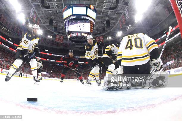 Tuukka Rask of the Boston Bruins gives up a goal to Calvin de Haan of the Carolina Hurricanes during the second period in Game Three of the Eastern...