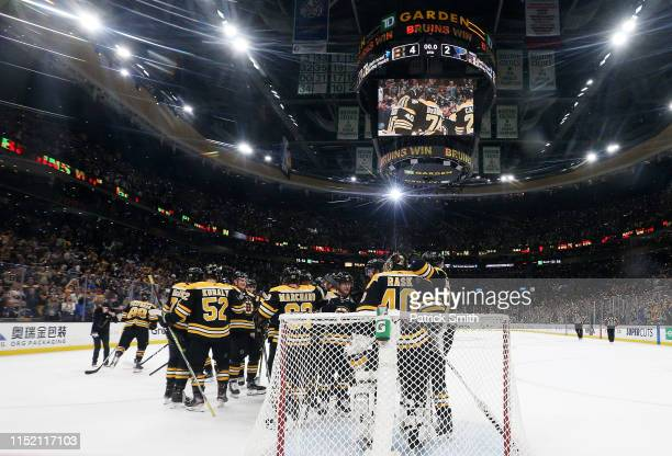 Tuukka Rask of the Boston Bruins is congratulated by his teammates after their 42 win over the St Louis Blues in Game One of the 2019 NHL Stanley Cup...
