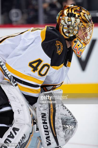 Tuukka Rask of the Boston Bruins looks down the ice against the Detroit Red Wings during an NHL game at Little Caesars Arena on February 9 2020 in...