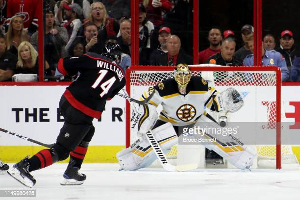 Tuukka Rask of the Boston Bruins makes a glove save shot by Justin Williams of the Carolina Hurricanes during the second period in Game Four of the...