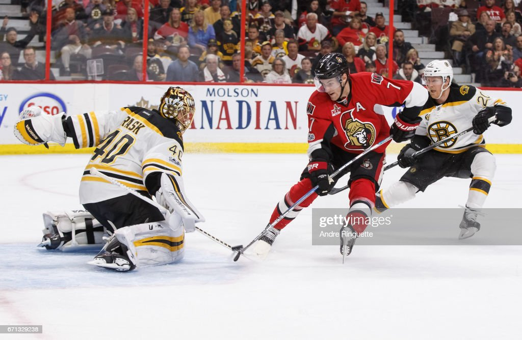 Tuukka Rask #40 of the Boston Bruins makes a save against a scoring chance in overtime by Kyle Turris #7 of the Ottawa Senators as Riley Nash #20 follows on the play in Game Five of the Eastern Conference First Round during the 2017 NHL Stanley Cup Playoffs at Canadian Tire Centre on April 21, 2017 in Ottawa, Ontario, Canada.