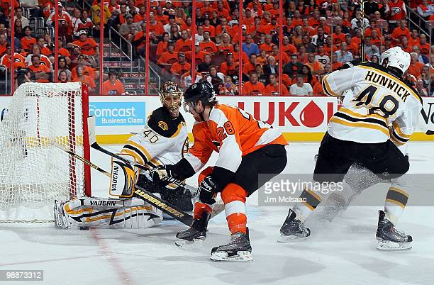 Tuukka Rask of the Boston Bruins makes a save against Claude Giroux of the Philadelphia Flyers in Game Three of the Eastern Conference Semifinals...