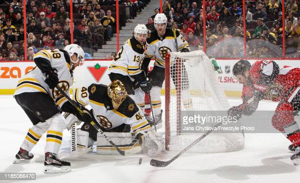 Tuukka Rask of the Boston Bruins makes a save against Connor Brown of the Ottawa Senators as Matt Grzelcyk Charlie Coyle and Brandon Carlo of the...