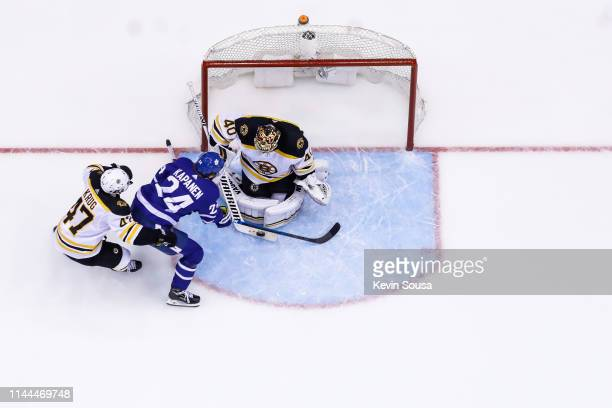 Tuukka Rask of the Boston Bruins makes a save against the Kasperi Kapanen of the Toronto Maple Leafs during the third period during Game Six of the...