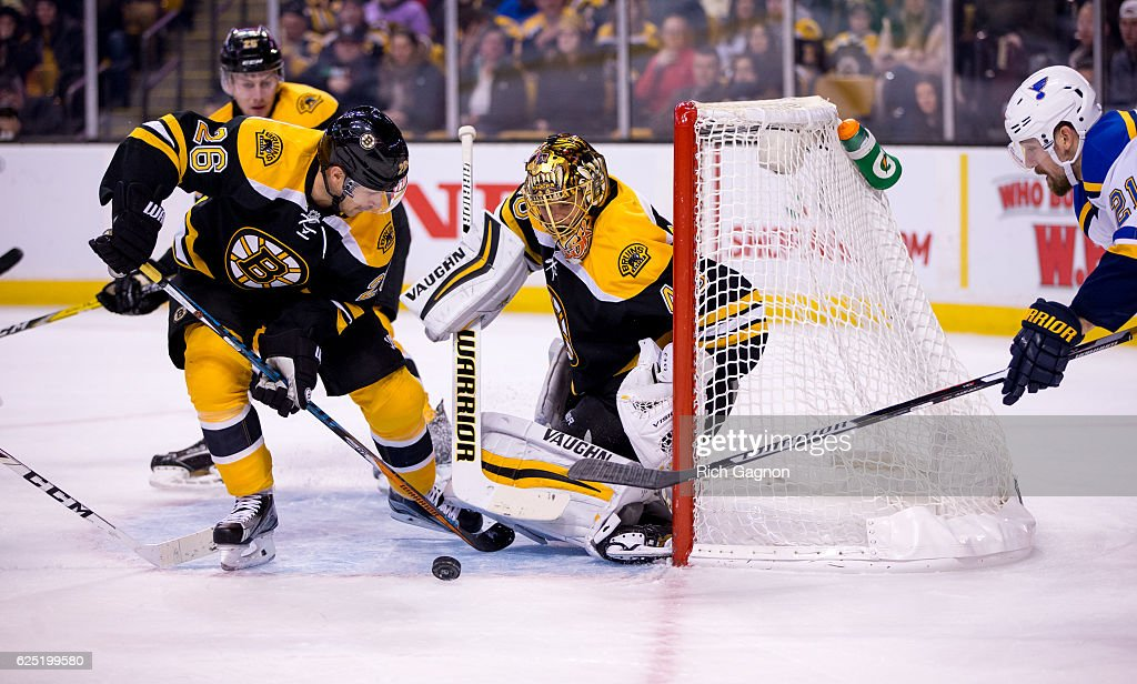 Tuukka Rask #40 of the Boston Bruins makes a save against the St. Louis Blues as teammate John-Michael Liles #26 clears the rebound during the second period at TD Garden on November 22, 2016 in Boston, Massachusetts. The Blues won 4-2.