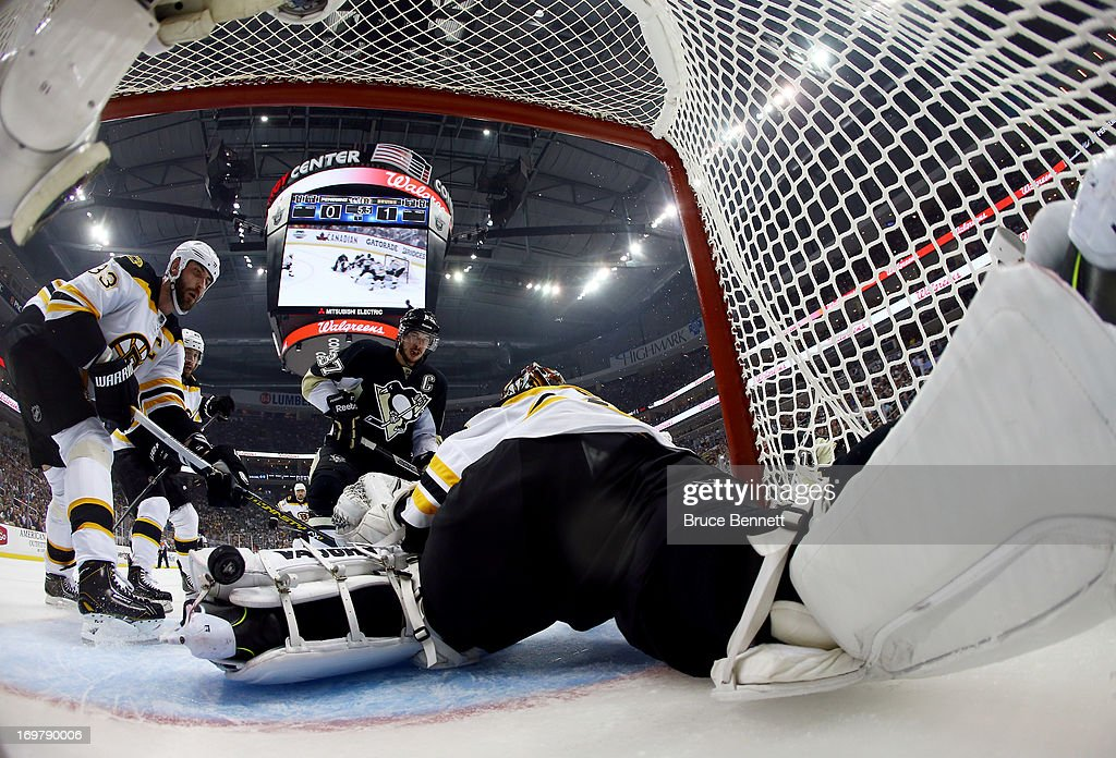 Tuukka Rask #40 of the Boston Bruins makes a save as Sidney Crosby #87 of the Pittsburgh Penguins looks on during Game One of the Eastern Conference Final of the 2013 NHL Stanley Cup Playoffs at the Consol Energy Center on June 1, 2013 in Pittsburgh, Pennsylvania.