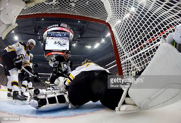 Tuukka Rask of the Boston Bruins makes a save as Sidney Crosby of the Pittsburgh Penguins looks on during Game One of the Eastern Conference Final of...