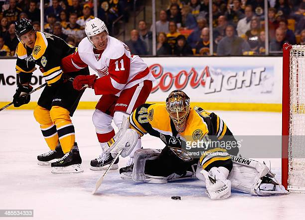 Tuukka Rask of the Boston Bruins makes a save in front of Daniel Alfredsson of the Detroit Red Wings in the second period in Game One of the First...