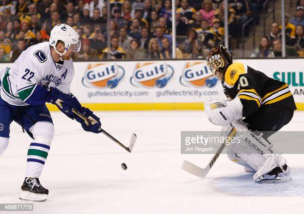 Tuukka Rask of the Boston Bruins makes a save on a shot Daniel Sedin of the Vancouver Canucks in the 1st period at TD Garden on February 4 2014 in...