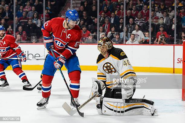 Tuukka Rask of the Boston Bruins makes a save with Max Pacioretty of the Montreal Canadiens standing in front during the NHL game at the Bell Centre...