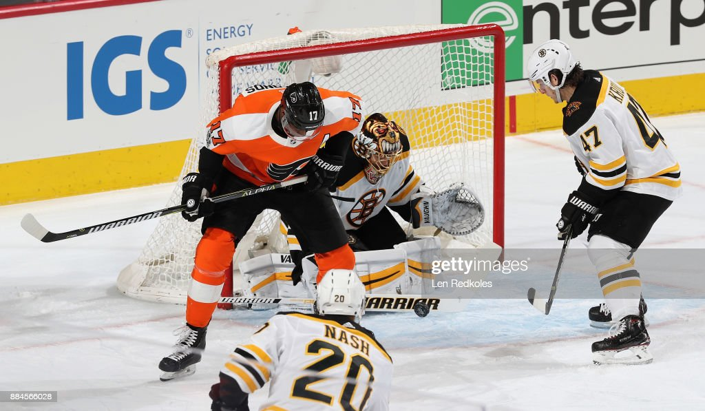Tuukka Rask #40 of the Boston Bruins makes a stick save as Torey Krug #47 skates in to defend against Wayne Simmonds #17 of the Philadelphia Flyers on December 2, 2017 at the Wells Fargo Center in Philadelphia, Pennsylvania. The Bruins went on to defeat the Flyers 3-0.
