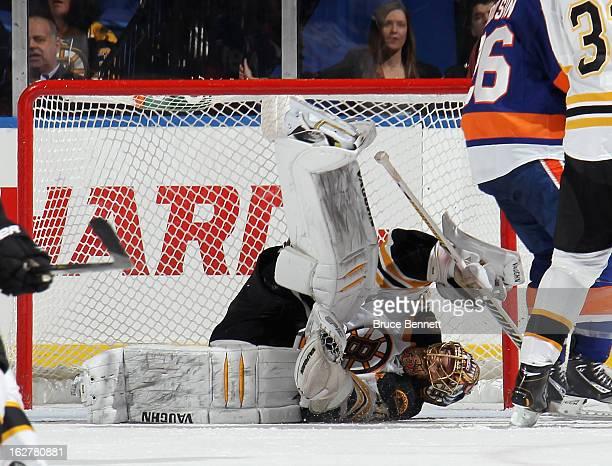 Tuukka Rask of the Boston Bruins makes a third period save against the New York Islanders at the Nassau Veterans Memorial Coliseum on February 26,...