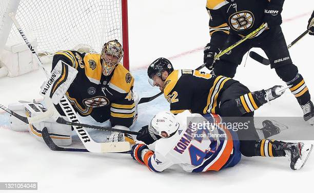 Tuukka Rask of the Boston Bruins makes the first period save against Leo Komarov of the New York Islanders in Game Two of the Second Round of the...