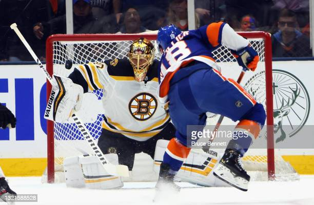 Tuukka Rask of the Boston Bruins makes the first period save on Anthony Beauvillier of the New York Islanders in Game Three of the Second Round of...