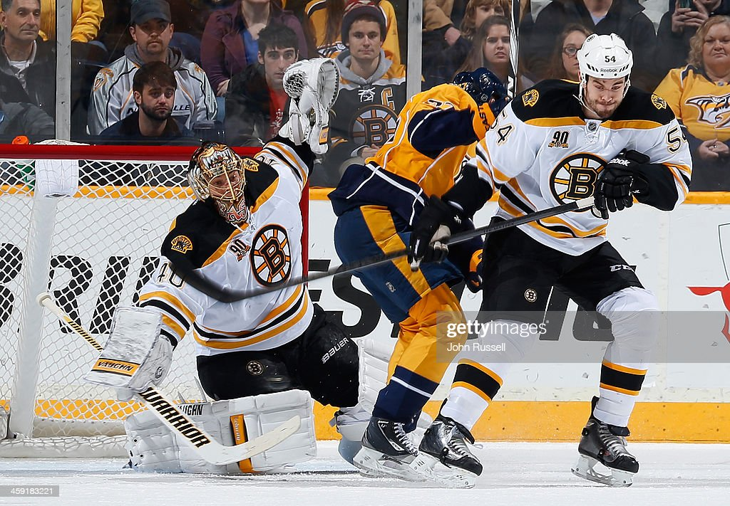 Tuukka Rask #40 of the Boston Bruins makes the save against the Nashville Predators at Bridgestone Arena on December 23, 2013 in Nashville, Tennessee.