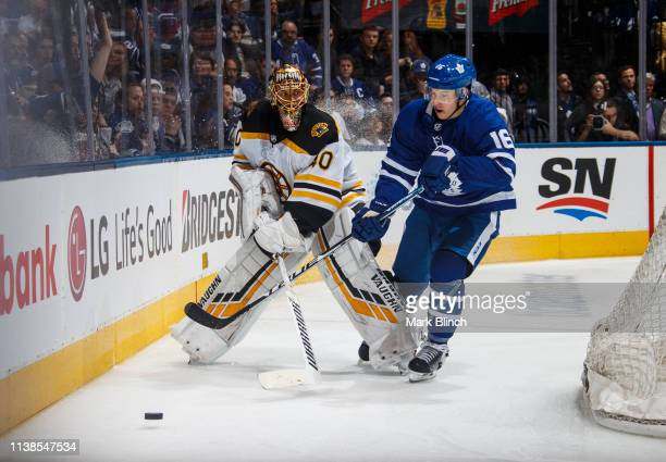 Tuukka Rask of the Boston Bruins plays the puck against Mitch Marner of the Toronto Maple Leafs during the third period during Game Six of the...