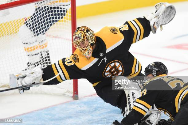 Tuukka Rask of the Boston Bruins reaches to catch the puck against the Buffalo Sabres at the TD Garden on November 21 2019 in Boston Massachusetts