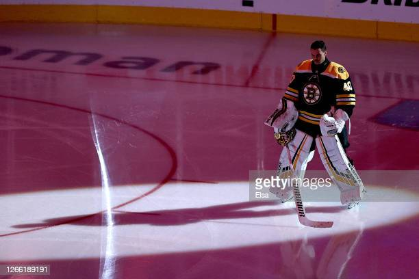 Tuukka Rask of the Boston Bruins stands for the national anthem prior to Game Two of the Eastern Conference First Round against the Carolina...