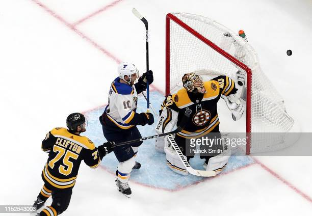 Tuukka Rask of the Boston Bruins stops a shot from Brayden Schenn of the St Louis Blues during the third period in Game Two of the 2019 NHL Stanley...