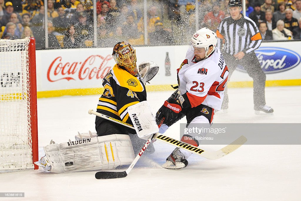 Tuukka Rask #40 of the Boston Bruins stops the puck against Kaspars Daugavins #23 of the Ottawa Senators at the TD Garden on February 28, 2013 in Boston, Massachusetts.