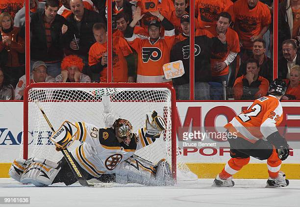 Tuukka Rask of the Boston Bruins stops Ville Leino of the Philadelphia Flyers on a penalty shot in Game Six of the Eastern Conference Semifinals...