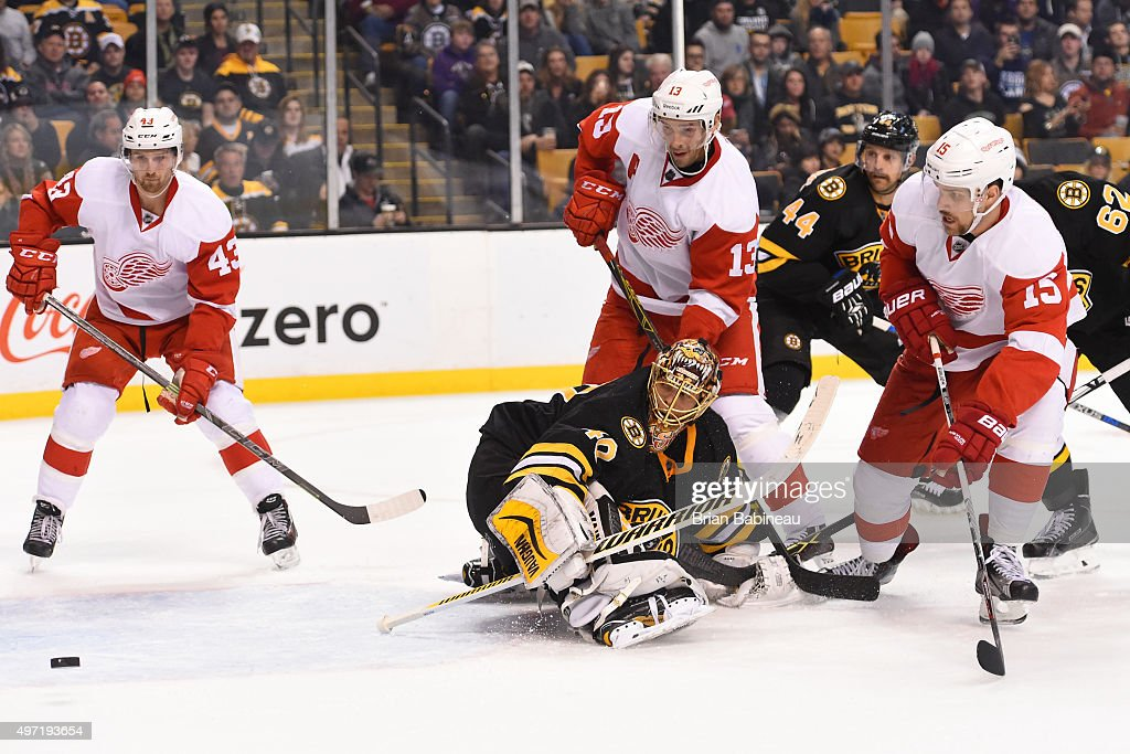 Tuukka Rask #40 of the Boston Bruins watches the loose puck against Darren Helm #43, Pavel Datsyuk #13 and Riley Sheahan #15 of the Detroit Red Wings at the TD Garden on November 14, 2015 in Boston, Massachusetts.