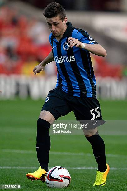 Tuur Dierckx of Club Brugge plays the ball during a preseason friendly against Barnsley at Oakwell Stadium on July 12 2013 in Barnsley England