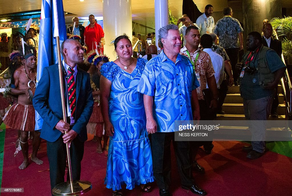 Tuvalu's Prime Minister Enele Sopoaga (C) arrives for the official opening of the 46th Pacific Islands Forum (PIF) in Port Moresby on September 8, 2015
