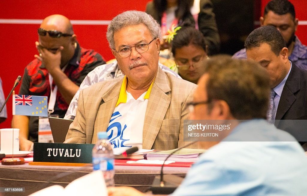 Tuvalu's Prime Minister Enele Sopoaga (C) listens to a speaker during the Smaller Islands States Leaders meeting as part of the Pacific Islands Forum in Port Moresby, Papua New Guinea, on September 7, 2015. Vulnerable Pacific island nations will this week send the world an urgent plea for action on climate change at crunch talks in Paris later this year. Some Pacific Islands Forum (PIF) countries lie barely a metre (three feet) above sea level and fear they will disappear beneath the waves without drastic intervention from major polluters. AFP PHOTO / Ness KERTON