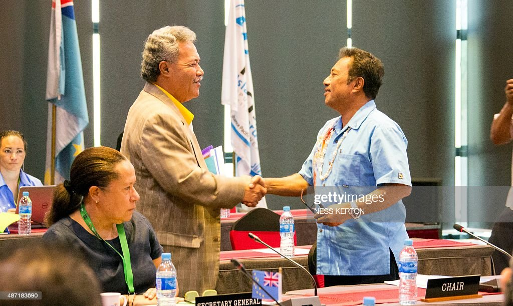 Tuvalu's Prime Minister Enele Sopoaga (L) shakes hands with Palau's President Tommy Remengesau (R) during the Smaller Islands States Leaders meeting as part of the Pacific Islands Forum in Port Moresby, Papua New Guinea, on September 7, 2015. Vulnerable Pacific island nations will this week send the world an urgent plea for action on climate change at crunch talks in Paris later this year. Some Pacific Islands Forum (PIF) countries lie barely a metre (three feet) above sea level and fear they will disappear beneath the waves without drastic intervention from major polluters. AFP PHOTO / Ness KERTON