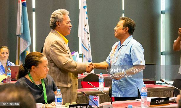 Tuvalu's Prime Minister Enele Sopoaga shakes hands with Palau's President Tommy Remengesau during the Smaller Islands States Leaders meeting as part...