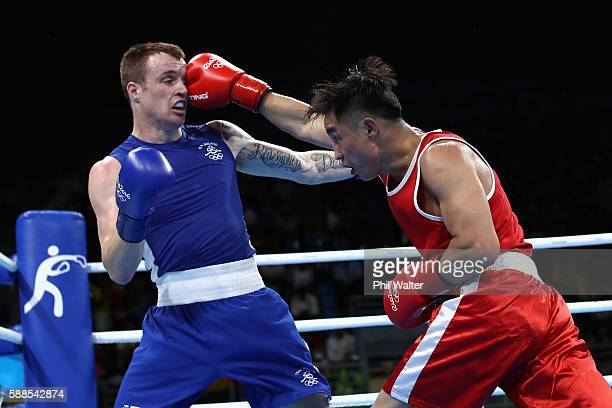 Tuvshinbat Byamba of Mongolia fights Steven Gerard Donnelly of Ireland in their Mens Welterweight bout on Day 6 of the 2016 Rio Olympics at Riocentro...