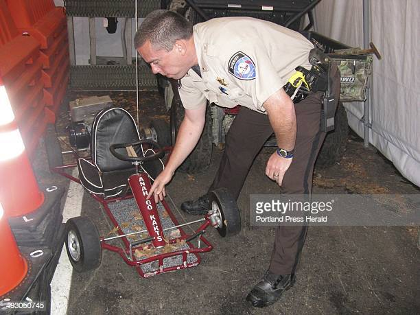 Lincoln County Sheriffs Lt Rand Maker points to frame damage on the gocart that was driven by Marvin Tarbox who was killed last year when his vehicle...