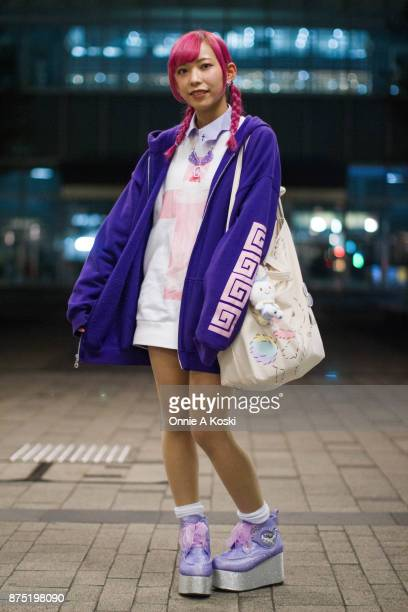 Tuxell with purple hair wearing a blue zip hoodie a Ezaki besuko white and pink shirt with lavender cross collar Yumetembo glitter platform purple...