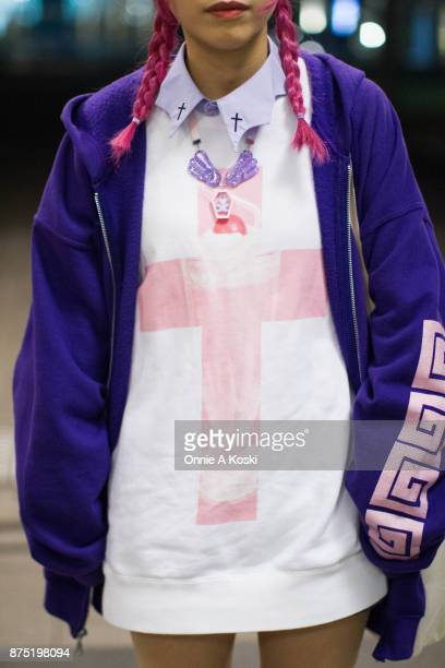 Tuxell with purple hair wearing a blue zip hoodie a Ezaki besuko white and pink shirt with lavender cross collar Yumetembo glitter platform purple...