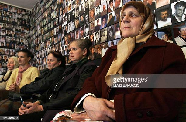 Muslim women of Eastern Bosnian town of Tulza gather at their association office on 11 March to watch the news relating the death of former Yogoslav...