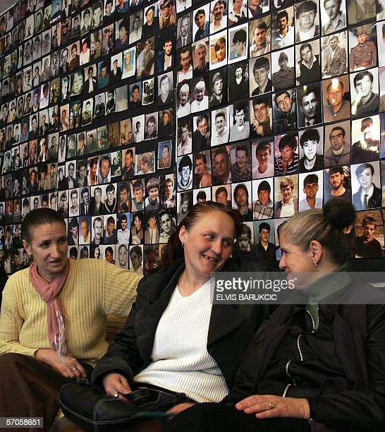 Muslim women of Eastern Bosnian town of Tulza talk after gathering at their association office on 11 March to watch the news relating the death of...