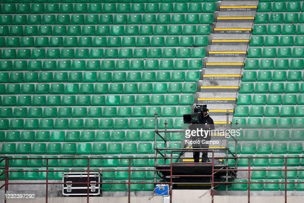 Tv camera is seen amidst empty stands during the Serie A football match between AC Milan and Genoa CFC. AC Milan won 2-1 over Genoa CFC.