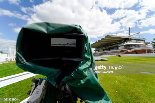 A tv camera with a head on view of the straight at Goodwood Racecourse on July 28 2020 in Chichester England Owners are allowed to attend if they...