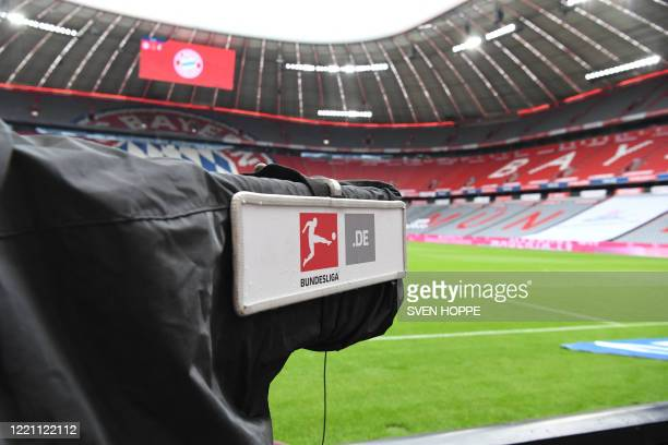Tv camera with the logo of the Bundesliga German league is seen at the empty Allianz Arena stadium prior to the German first division Bundesliga...