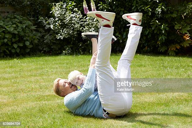 Tv commentator and former champion player Boris Becker with his son Amadeus are photographed at home for Hello magazine on June 15 2015 in London...