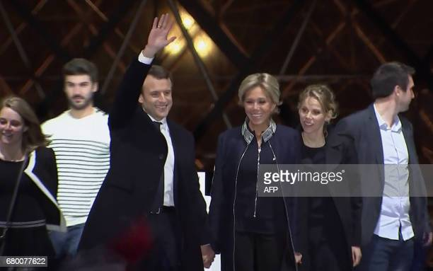 A tv grab shows French presidentelect Emmanuel Macron his wife Brigitte Trogneux her daughter Tiphaine Auziere and the latter's husband Antoine...