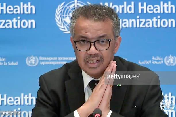 A tv grab taken from the World Health Organization website shows WHO Chief Tedros Adhanom Ghebreyesus delivering a virtual news briefing on COVID19...