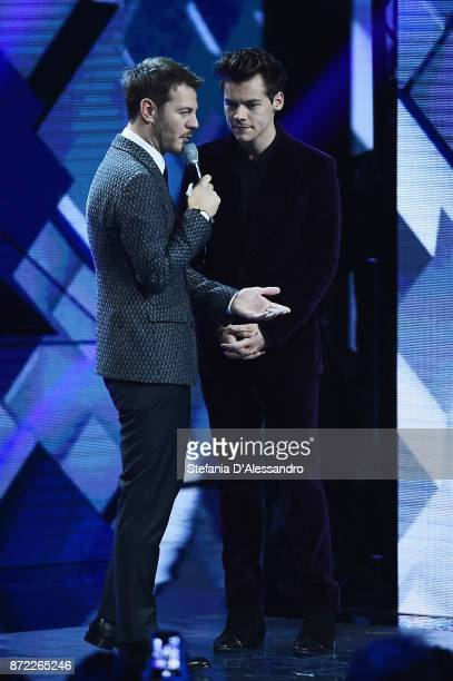 Tv host Alessandro Cattelan and Harry Styles attend X Factor 11 tv show on November 9 2017 in Milan Italy